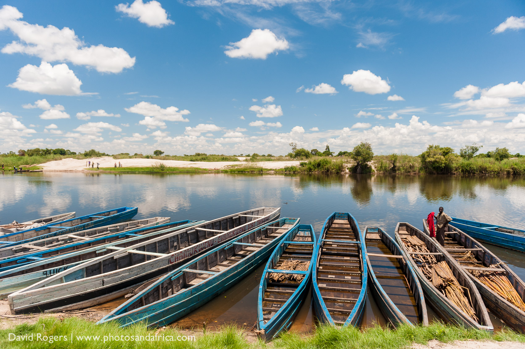 Zambia, Liuwa Plains National Park, view of fishing boats on the Luanginga River at the gateway to the park at Kalabo